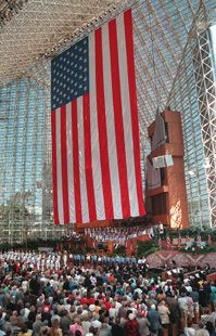 A huge 10-story high flag hangs from the rafters of the famed  Crystal Cathedral on Sunday, May 26, 1996 in Garden Grove, Calif.  The towering ensign was unfurled during an early morning service as part of the Memorial Day activities. (AP Photo/Bob Riha Jr.)
